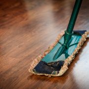 broom on wooden floor