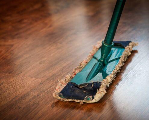 broom on wooden floor