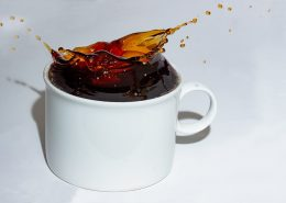 coffee splashing out of cup